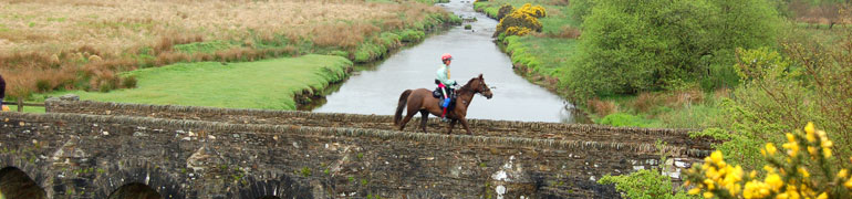 Riding across Landacre Bridge over the River Barle